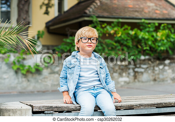 Outdoor portrait of a cute little boy in glasses - csp30262032