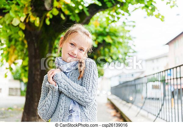 Outdoor portrait of a cute little girl - csp26139016