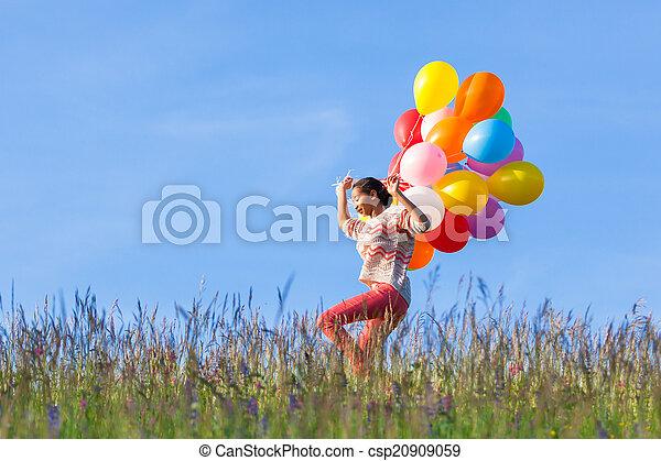 Outdoor portrait of a young African American teenage girl runnin - csp20909059