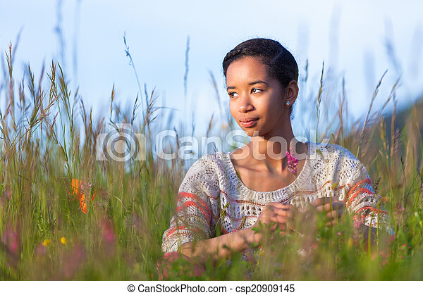 Outdoor portrait of a young African American teenage girl - csp20909145