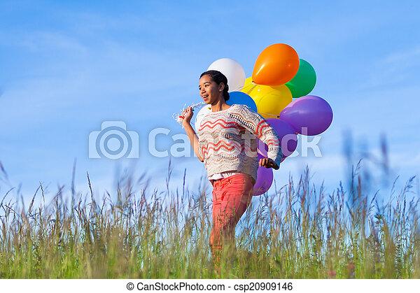 Outdoor portrait of a young African American teenage girl runnin - csp20909146