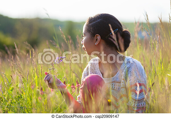 Outdoor portrait of a young African American teenage girl - csp20909147