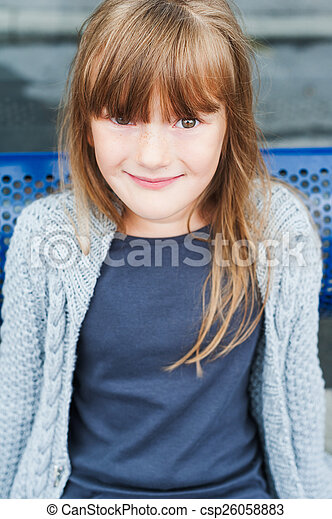 Outdoor portrait of adorable little girl in a city - csp26058883