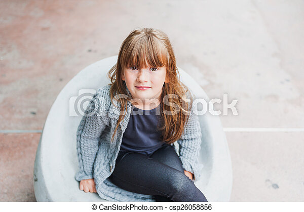 Outdoor portrait of adorable little girl in a city - csp26058856