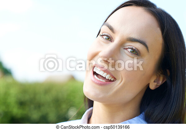 Outdoor Portrait Of Woman With Perfect Teeth And Beautiful Smile - csp50139166