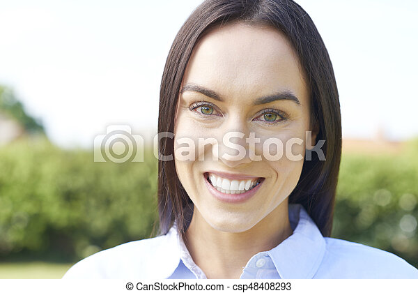 Outdoor Portrait Of Woman With Perfect Teeth And Beautiful Smile - csp48408293