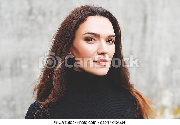 Outdoor Portrait Of Young 35 Year Old Woman With Long Dark Hair Wearing Black Turtle Neck Dress