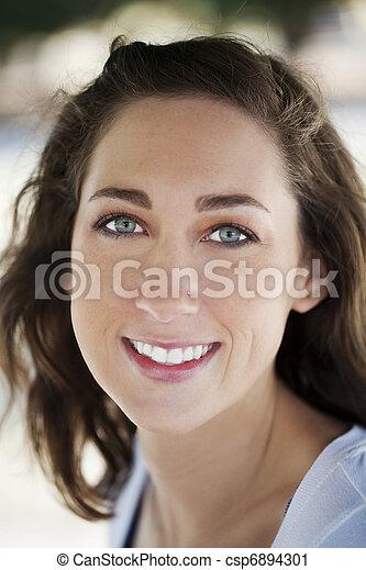 Outdoor portrait of young caucasian woman - csp6894301
