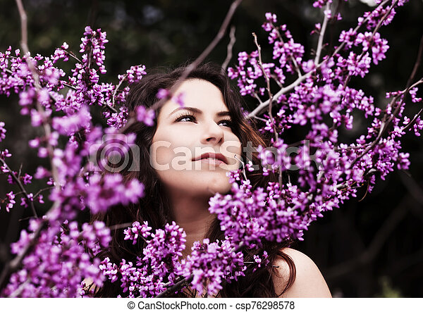Outdoor Portrait Of Young Caucasian Woman Amid Spring Blossoms - csp76298578