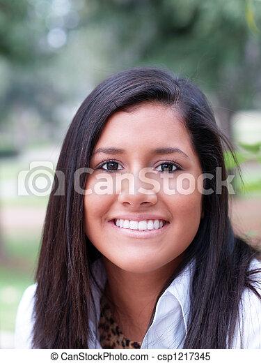 Outdoor portrait of young hispanic teen girl - csp1217345