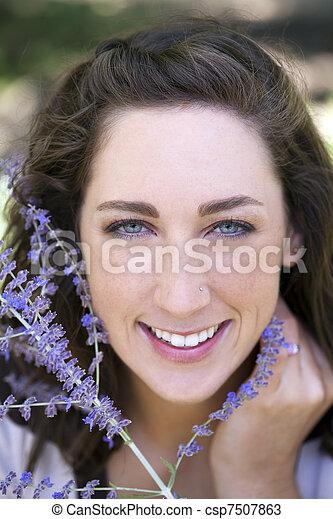 Outdoor portrait smiling attractive young caucasian woman - csp7507863