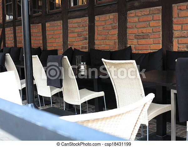 Outdoor restaurant open air cafe chairs with table - csp18431199