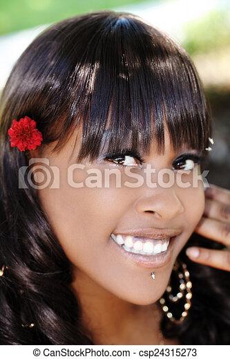 Outdoor Smiling Portrait Attractive African American Woman - csp24315273