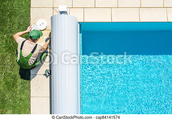 Outdoor Swimming Pool Skimmer Filter Cleaning Aerial View - csp84141574