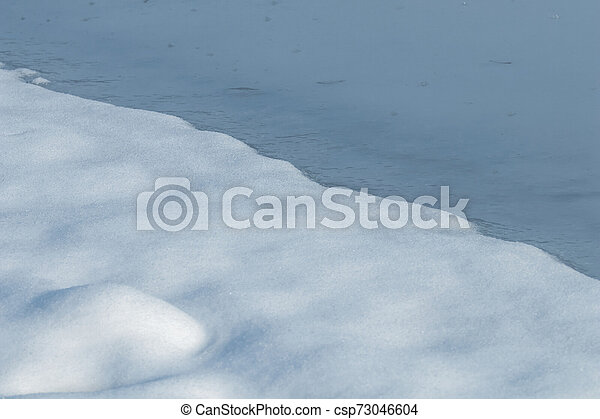 Outdoor view of frozen lake in winter - csp73046604