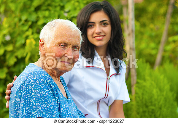 Outdoors with an elderly woman - csp11223027