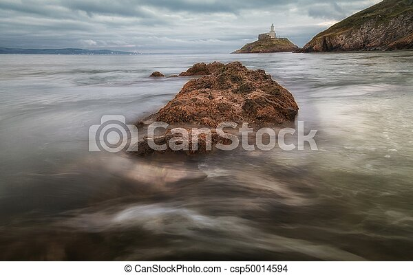 Outgoing tide at Mumbles lighthouse - csp50014594