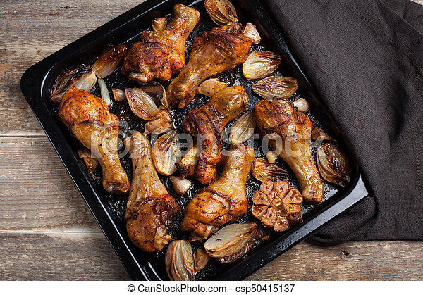 Oven Baked Chicken Leg Quarters With Onion Garlic And Capsicum On A