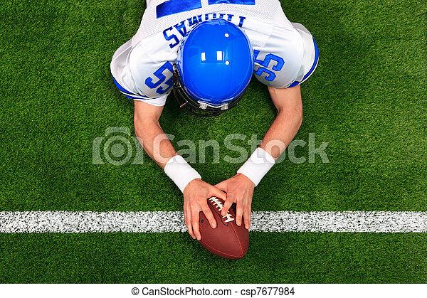 Overhead American football player touchdown - csp7677984