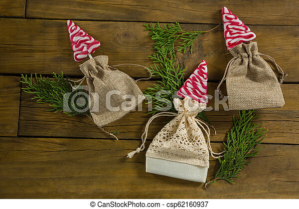 Overhead view of mint candies in jute sack with twigs - csp62160937