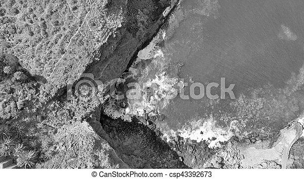 Overhead view of rocks along ocean - csp43392673