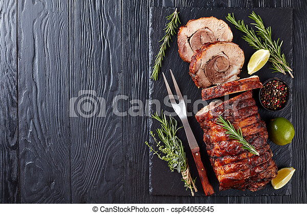 overhead view of sliced roast pork roulade - csp64055645