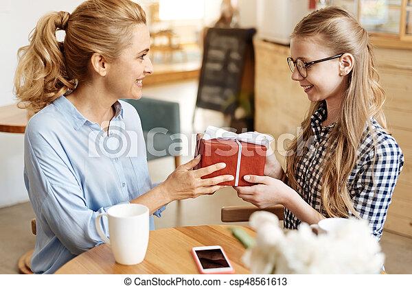 Overjoyed Teenage Girl Getting Her Birthday Present