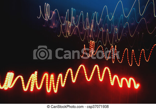 Overlaying wavy lines forming an abstract pattern on a dark background. - csp37071938