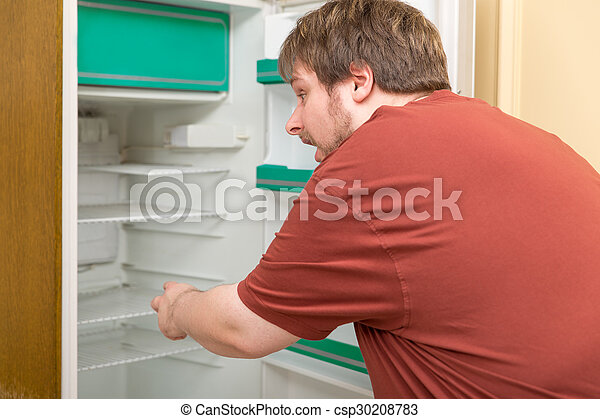 overweight man in front of a empty fridge - csp30208783