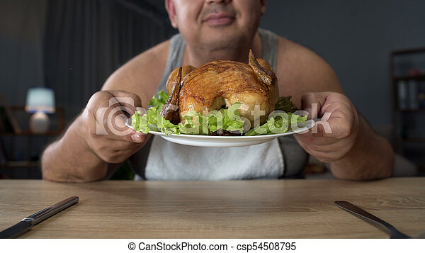 Overweight Man Smelling Greasy Grilled Chicken With Enjoyment