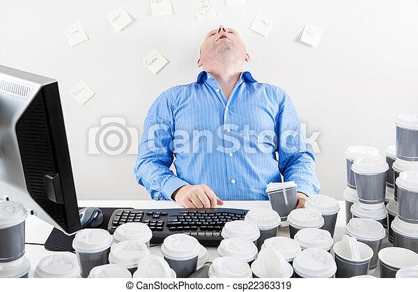 Overworked businessman drinks too much coffee - csp22363319