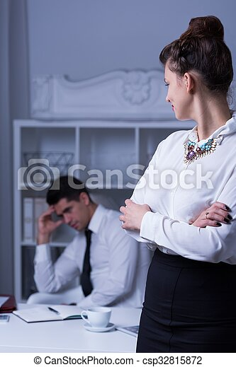 Overworked businessman in the office - csp32815872