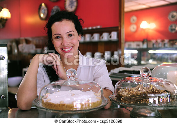 owner of a small business store showing her tasty cakes - csp3126898