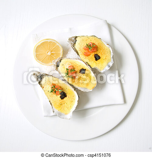 oysters with sauce and lemon - csp4151076