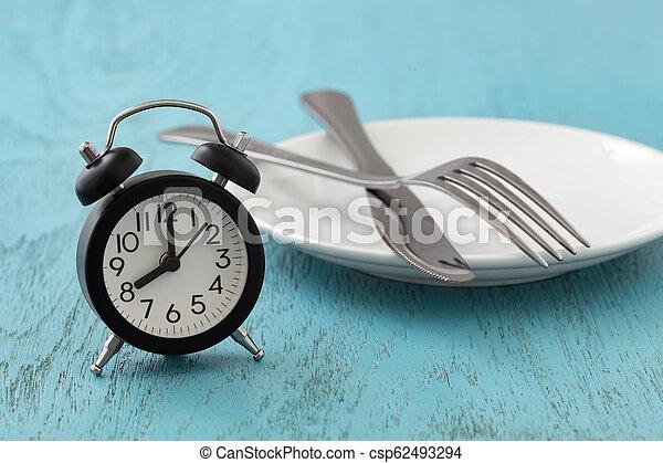 Ayuno intermitente, dieta, concepto de pérdida de peso - csp62493294