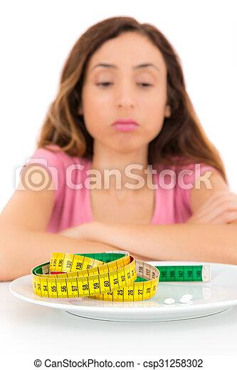 La mujer que pierde peso es infeliz - csp31258302