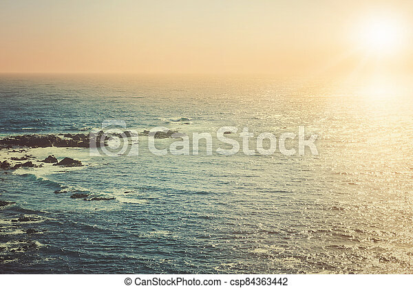 Pacific ocean at sunset - csp84363442