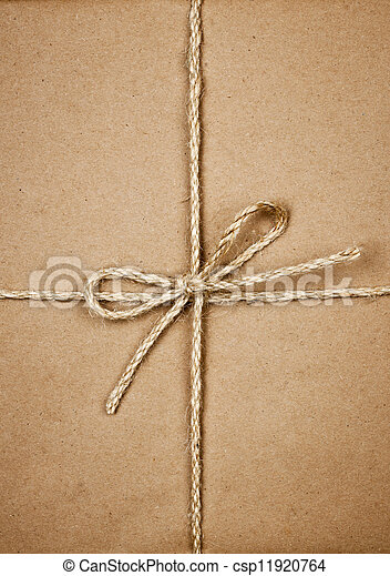 Package in brown paper tied with string - csp11920764