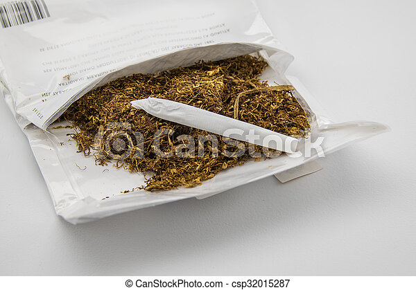 package of tobacco and hand made cigarette - csp32015287