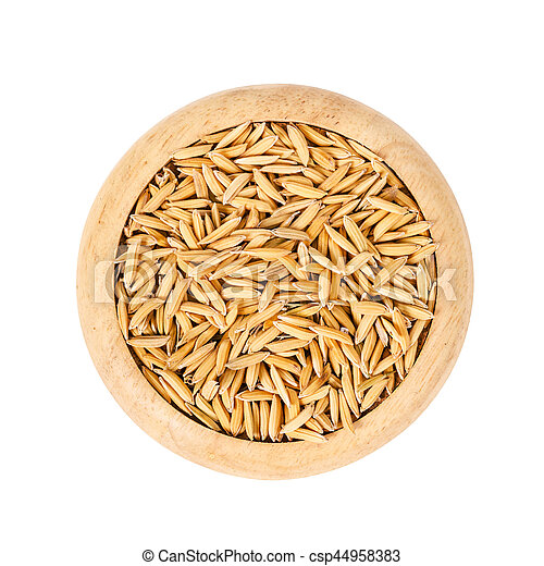 Paddy rice in wooden dish. - csp44958383