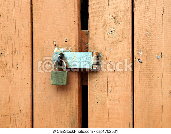Padlock hasp on weathered painted door - csp1702531 & Padlock hasp on weathered painted door. Rusty padlock and... stock ...