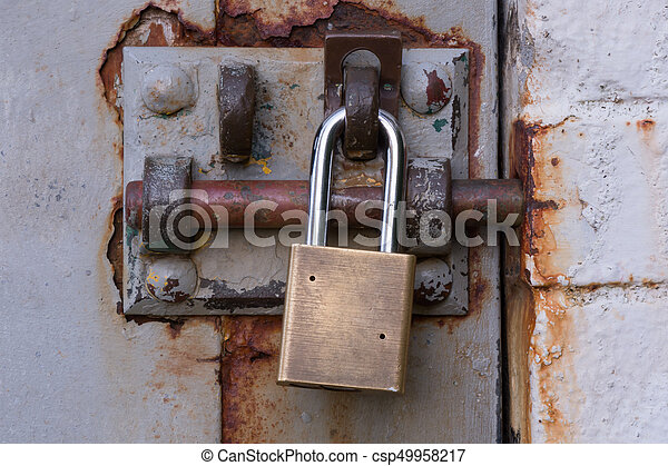 Padlock on Rusty Bolted Door - csp49958217 & Padlock on rusty bolted door close up stock photography - Search ...