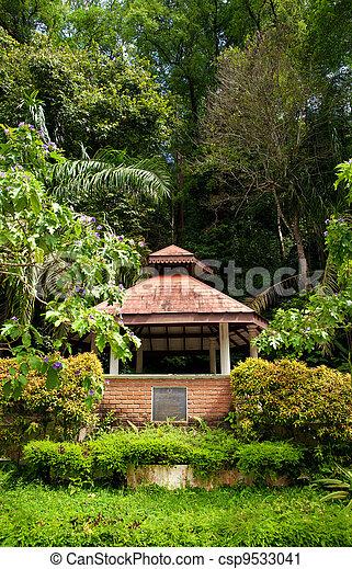 Pagoda or rotunda in garden. A pagoda in the lush green garden.