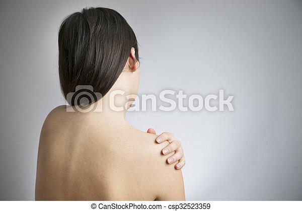 Pain in the women's shoulder - csp32523359