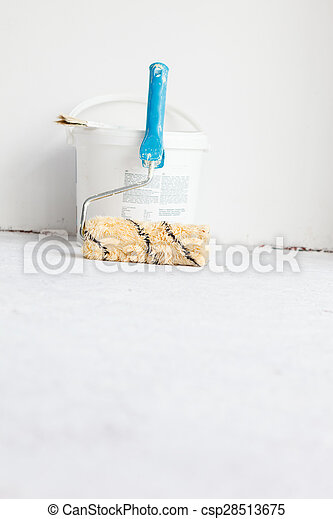 Paint bucket with roller brush on white. - csp28513675
