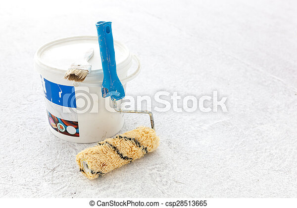 Paint bucket with roller brush on white. - csp28513665