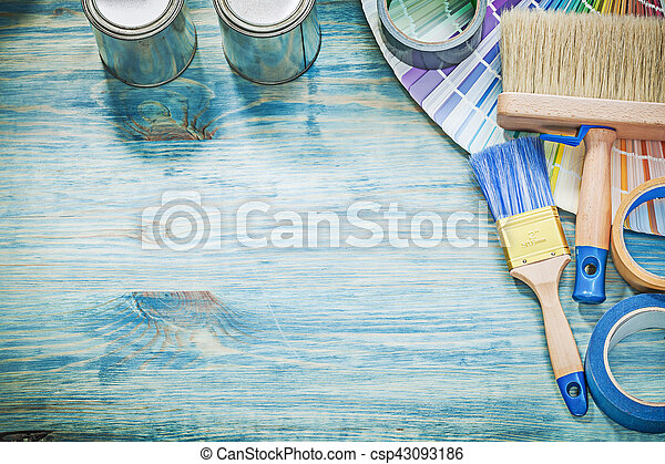 Paint cans brushes pantone fan adhesive tape on wooden board - csp43093186
