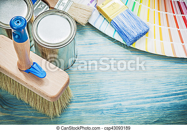 Paint cans brushes pantone fan on wooden board construction conc - csp43093189