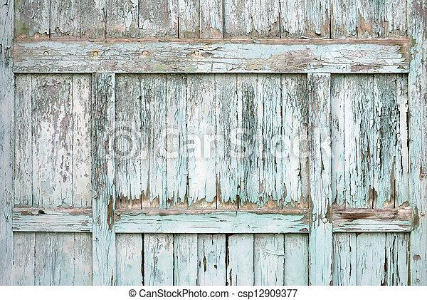 Paint-peeling wooden old door texture detail - csp12909377