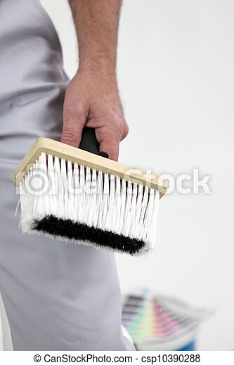 painter holding a brush - csp10390288